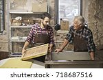 elderly artisan and young... | Shutterstock . vector #718687516