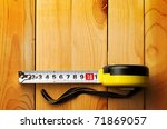 tape measure isolated on wooden ...
