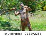Small photo of KURANDA, AUSTRALIA - NOVEMBER 07, 2007: Unidentified aborigine actor throws a spear in the Tjapukai Culture Park in Kuranda, Queensland, Australia.