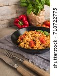 italian wholemeal pasta with... | Shutterstock . vector #718722775