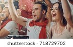 group of fans cheer for their... | Shutterstock . vector #718729702