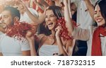 group of fans cheer for their... | Shutterstock . vector #718732315