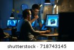 two male game developers... | Shutterstock . vector #718743145