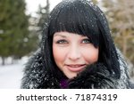 girl in snowflake look at camera smiling - stock photo