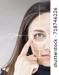 woman pointing to eye | Shutterstock . vector #718746226