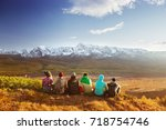 group of friends having rest on ... | Shutterstock . vector #718754746