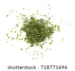 dried parsley isolated on white ... | Shutterstock . vector #718771696