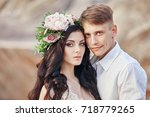 portrait of the bride and groom ... | Shutterstock . vector #718779265