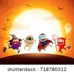 Stock vector halloween kids costume party group of kids in halloween costume jumping in the moonlight orange 718780312