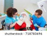 santa claus at a reception at... | Shutterstock . vector #718783696