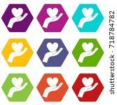 hand holding heart icon set... | Shutterstock .eps vector #718784782