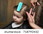 a little boy is trimmed in the... | Shutterstock . vector #718792432