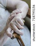wrinkled hand of a senior woman ... | Shutterstock . vector #718795156