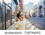 young tourist walks the streets ... | Shutterstock . vector #718796692