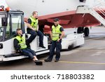 workers sitting on towing truck ... | Shutterstock . vector #718803382