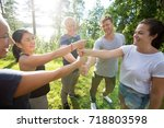 coworkers stacking fists while... | Shutterstock . vector #718803598