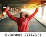 young female runner jogging... | Shutterstock . vector #718817146