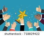 businessman holding star trophy ... | Shutterstock .eps vector #718829422