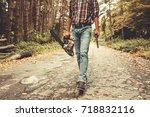lumberjack worker walking in... | Shutterstock . vector #718832116
