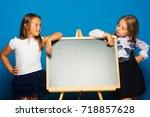 girls in school uniform on blue ... | Shutterstock . vector #718857628