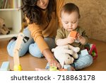 mother playing with her baby  ... | Shutterstock . vector #718863178