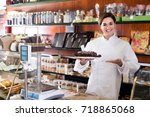glad female seller offering... | Shutterstock . vector #718865068