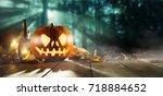 spooky halloween pumpkins on... | Shutterstock . vector #718884652