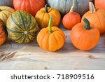 various kinds of pumpkins on... | Shutterstock . vector #718909516