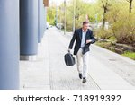 businessman running in the city ... | Shutterstock . vector #718919392