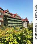green building with balconies... | Shutterstock . vector #718925632