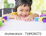 little girl playing with... | Shutterstock . vector #718928272