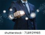 businessman clicks on the... | Shutterstock . vector #718929985