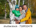 happy family of three playing... | Shutterstock . vector #718932478