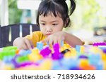 little girl playing with... | Shutterstock . vector #718934626