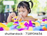 little girl playing with... | Shutterstock . vector #718934656