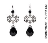 silver earrings with black... | Shutterstock . vector #718945132