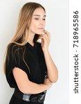 beautiful young woman posing  | Shutterstock . vector #718965586