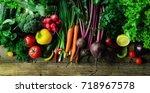 vegetables on wooden background.... | Shutterstock . vector #718967578