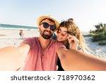 traveling couple in love  ... | Shutterstock . vector #718970362