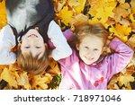 happy schoolboy and little girl ...   Shutterstock . vector #718971046