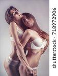 two beautiful sexy lesbian... | Shutterstock . vector #718972906