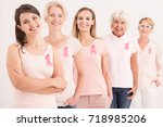 women wearing pink shirts and... | Shutterstock . vector #718985206