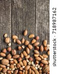 different types of nuts in the... | Shutterstock . vector #718987162