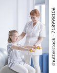 active girl sitting on the ball ... | Shutterstock . vector #718998106