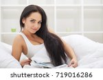 Small photo of woman sleep and hold her head with subliminal stress or other possible symptoms