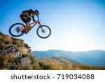professional rider is jumping... | Shutterstock . vector #719034088