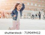 funny little girl having fun in ... | Shutterstock . vector #719049412