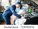 portrait of a mechanic at work... | Shutterstock . vector #719050576