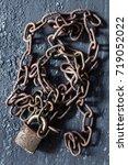 metal chain and locked padlock | Shutterstock . vector #719052022
