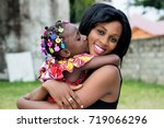 smiling young mother hugs her... | Shutterstock . vector #719066296